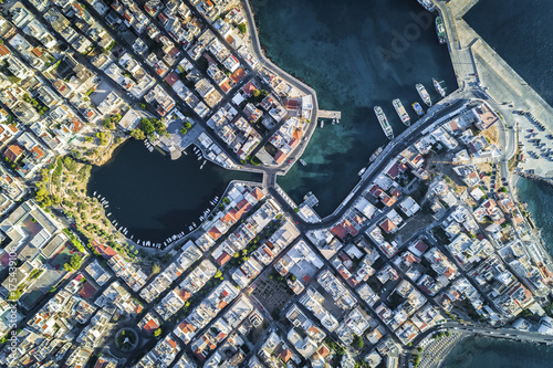 Aerial view of streets, buildings and Voulismeni Lake in Agios Nikolaos Crete, Greece. Top view