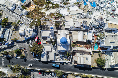 Aerial top view of street and blue dome church in Santorini Island, Greece