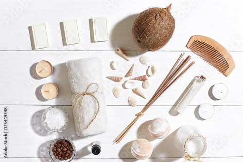 In de dag Spa Spa set with sea salt, essential oil, soap and towel decorated with seashells on white wooden background