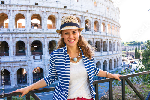 happy young woman in front of Colosseum in Rome, Italy