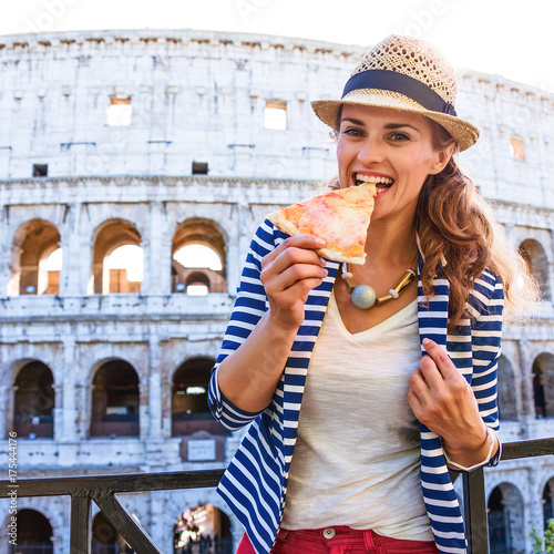 happy stylish tourist woman in Rome, Italy eating pizza