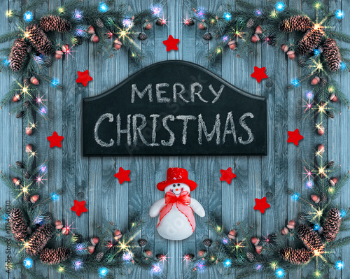 Christmas omposition with Snowman and signboard with greeting Poster