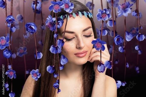Flowers portrait of young beautiful woman with natural makeup Poster