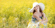 Quadro Happy Young Woman Enjoying Summer on the Yellow Meadow.