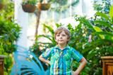 Little blond preschool kid boy discovering flowers and butterflies at botanic garden - 175459146