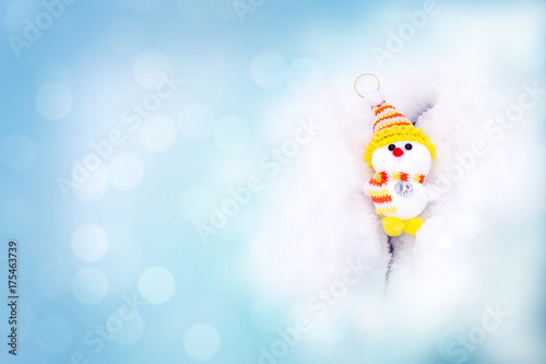 Snowman in snow on blue background with bokeh. Christmas card Poster