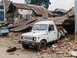 Aftermath of Nepal earthquake 2015, crushed car and collapsed buildings in Kathmandu - 175463909