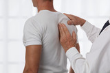 Chiropractic back adjustment. Osteopathy, Alternative medicine, pain relief concept. Physiotherapy, sport injury rehabilitation - 175465727