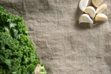 Fresh kale leaves with garlic on napkin - 175466555