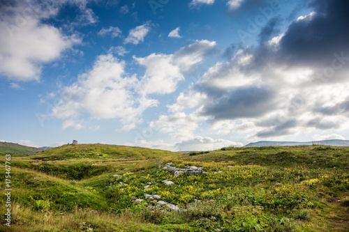 Fotobehang Lente Beautiful mountain landscape. Green hills and blue sky with