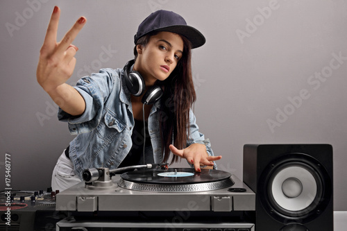 Female DJ making a peace sign Poster