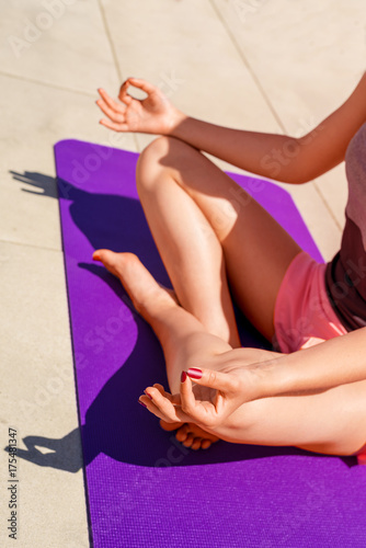 Plakat Young woman yoga positon lotus, relaxed.