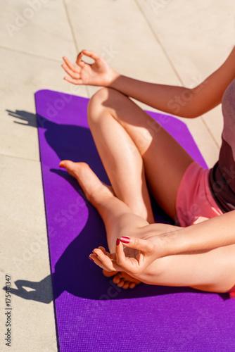 Fototapeta Young woman yoga positon lotus, relaxed.