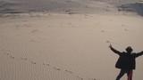Rock star walking On the sand dunes of Mojave Desert music life in Palm Springs California area summer fall sunset - 175502751