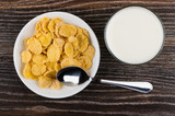 Saucer with corn flakes, glass of milk and spoon - 175504560