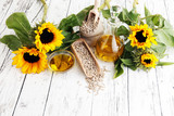 Sunflower oil, sunflower and seeds on white background - 175506765
