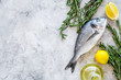Quadro Fresh dorado fish ready to cook on grey background top view copyspace