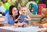 Cheerful bright colorful birthday celebration for beautiful baby boy with fun smiling mom - 175524799