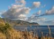 Beautiful mountain and ocean view with clouds drifted across blue sky, Kaena Point, Oahu, Hawaii