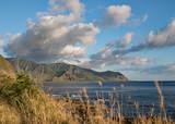 Beautiful mountain and ocean view with clouds drifted across blue sky, Kaena Point, Oahu, Hawaii - 175543505