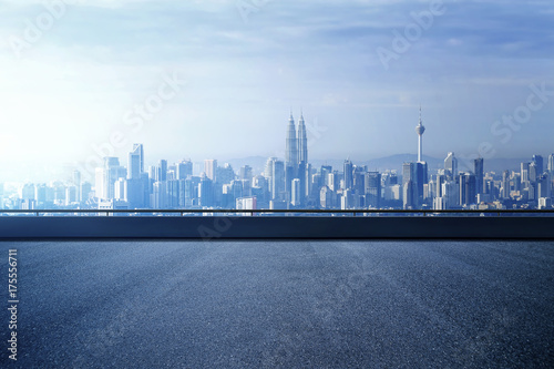 Plexiglas Kuala Lumpur Highway overpass with modern city skyline background