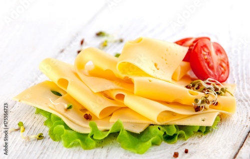 slices of cheese with tomatoes - 175556723