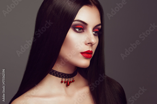 Keuken foto achterwand Kapsalon Halloween Vampire Woman portrait. Beautiful Glamour Fashion Sexy Vampire Lady with long dark Hair, beauty Make Up and Costume