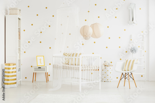 Papiers peints Kiev White chair next to baby's bed
