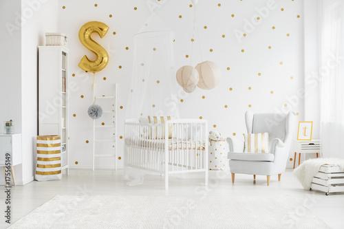 Fototapeta Child's bedroom with gold balloon