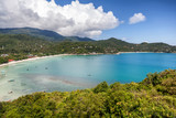 Beautiful tropical beach with blue water and green hills, top view - 175566941