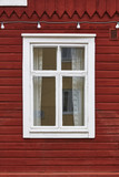 Traditional red wooden facade with white window. Vintage background - 175569349