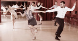 Dancing couples enjoying latin dances - 175575101