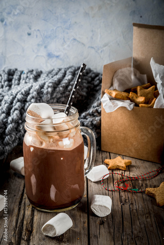 Fotobehang Chocolade Traditional autumn winter drinks and treats. Cup of hot chocolate with marshmallow and ginger biscuit stars, in gift box, old rustic wooden table. Cozy atmosphere, copy space