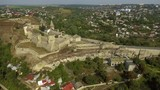 Aerial view of Kamianets-Podilskyi castle in Ukraine. The fortress located among the picturesque nature in the historic city of Kamianets-Podilskyi, Ukraine. - 175584713
