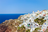Panoramic view of Oia village with the sea in the background. Santorini island, Greece - 175585143