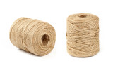 Two coil bobbins of burlap jute twine over white - 175586587