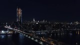 Aerial view of Brooklyn bridge and New York cityscape at night - 175589150