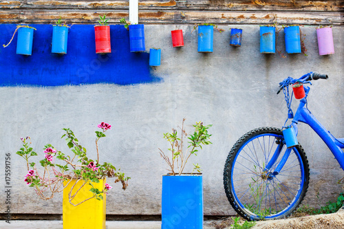 Decoration wall in greek style with flower and old rusty bike.