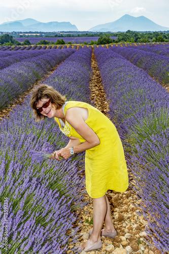 Fotobehang Lavendel Woman in flowering lavender field