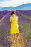 Woman in flowering lavender field - 175593762