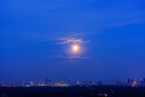 Scenery of full moon rising in blue hour , Bangkok , Thailand - 175601508