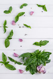 Fresh green basil leaves with garlic and pepper on white background. Flat lay. - 175604344