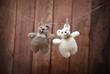 Two knitted bears on a cloth rope  - 175613165