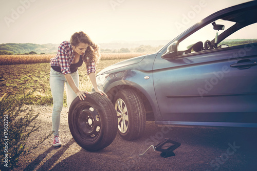 Beautiful young woman on the road, problem with her car