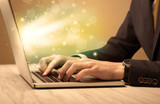 Businessman working fast on laptop - 175646555