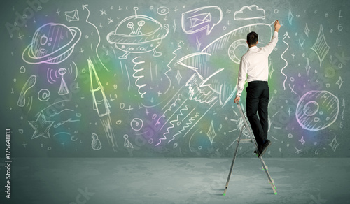 Keuken foto achterwand UFO Young businessman drawing rocket