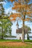 Early autumn landscape. Herreninsel, Lake Chiemsee with Holy Cross chapel during fall, Bavaria, Germany - 175648572