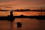 Jersey harbour, U.K.  Sunset at high tide. - 175652344