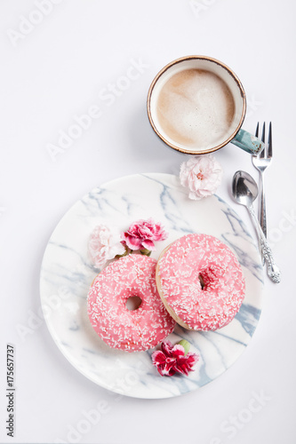 Wall mural Two fresh donuts with a cup of cappuccino, on white