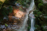 waterfall with a abstract rock face - 175660961